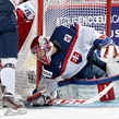 MONTREAL, CANADA - JANUARY 2: Slovakia's Denis Godla #30 reaches to cover a loose puck against Team Czech Republic during quarterfinal round action at the 2015 IIHF World Junior Championship. (Photo by Richard Wolowicz/HHOF-IIHF Images)